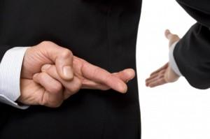 crossed-fingers-at-handshake